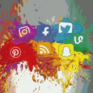 Social media icons on splattered paind
