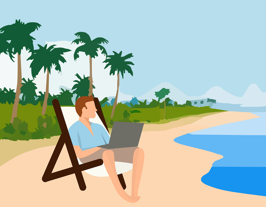 man on beach with laptop, laptop lifestyle