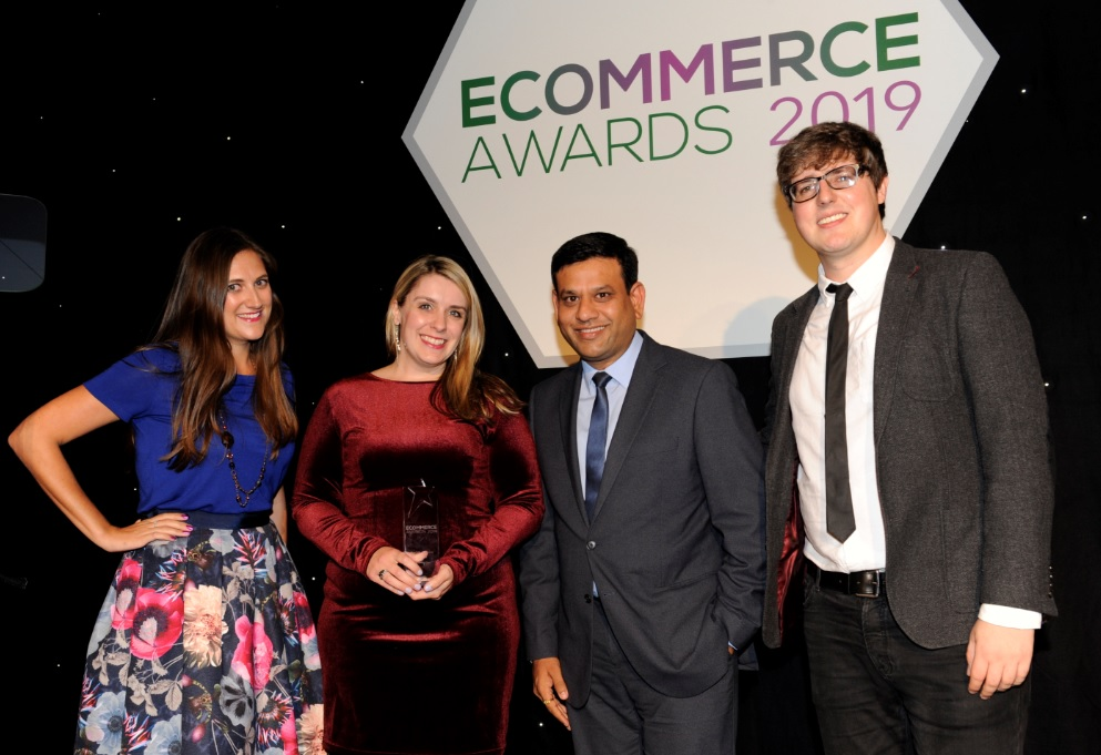 Dawn and Pranav collecting trophy at the eCommerce Awards 2019